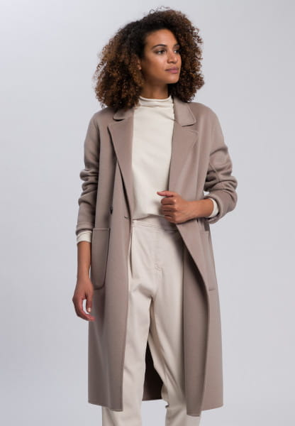 Double face coat with external pockets