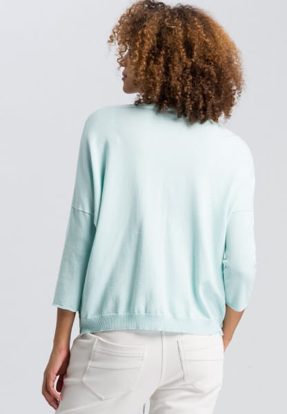 Poncho sweater with rib details