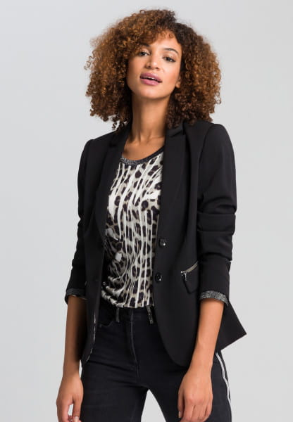 Blazer with metallic details and brooch