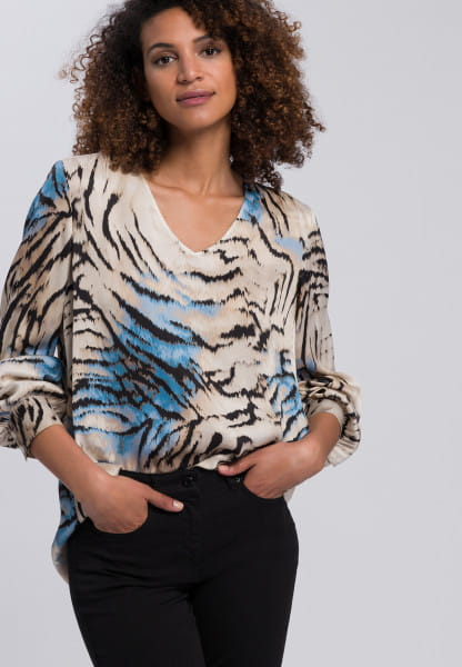 Slip-on blouse with abstract animal print