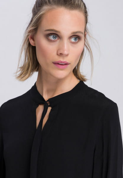 Slip-on blouse with stepped skirt