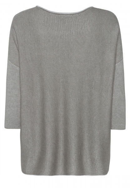 Poncho sweater with rolled edge