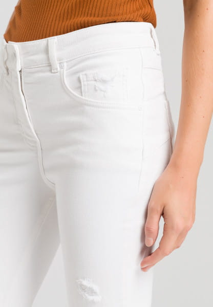 Pants in white denim look with destroyed effects