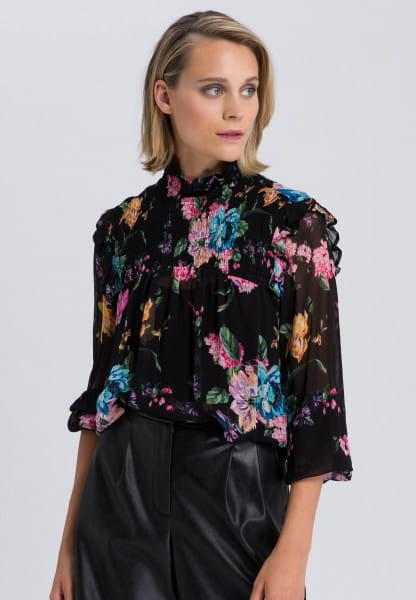 Bluse und Top mit floralem Muster