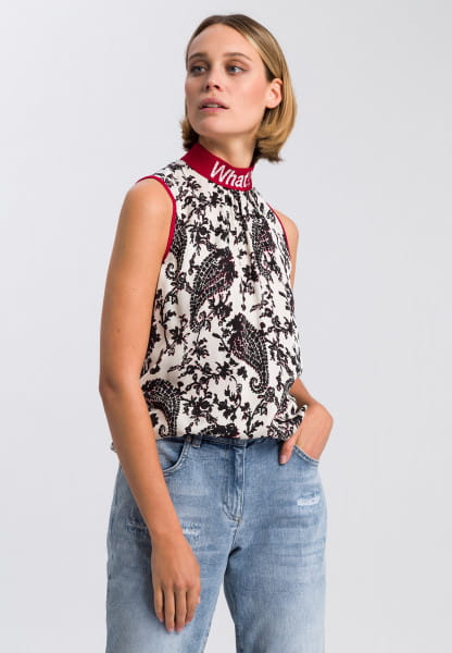 Shirt blouse with paisley print and statement