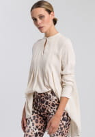 Blouse with flowing pleat details