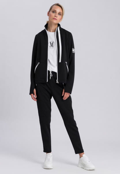 Training jacket with thumbholes at the end of the sleeves