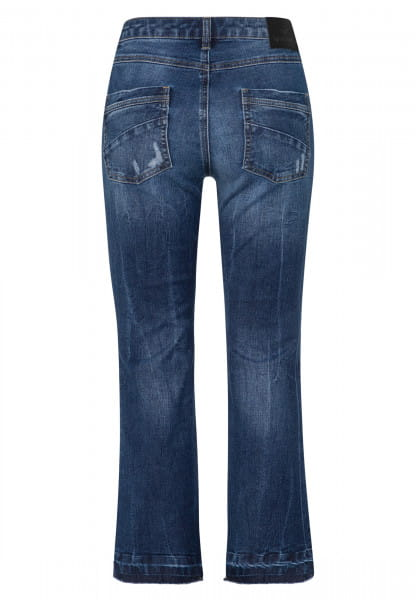 Jeans with decorative distressed effects