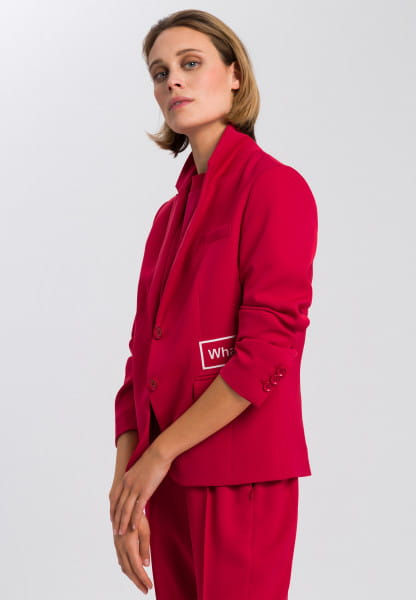 Blazer made from crease-free material with badges