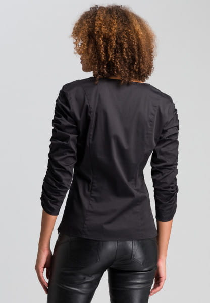 Blouse with ruffled arm