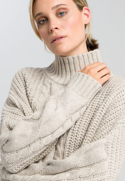 Boxy sweater with cable knit pattern