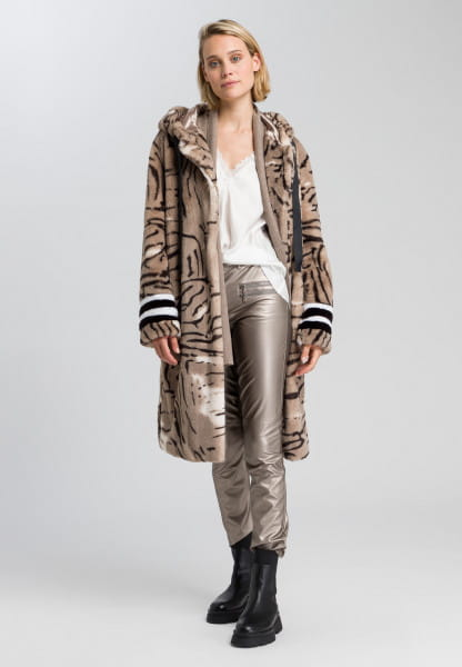 Faux fur coat with abstract animal print and badges