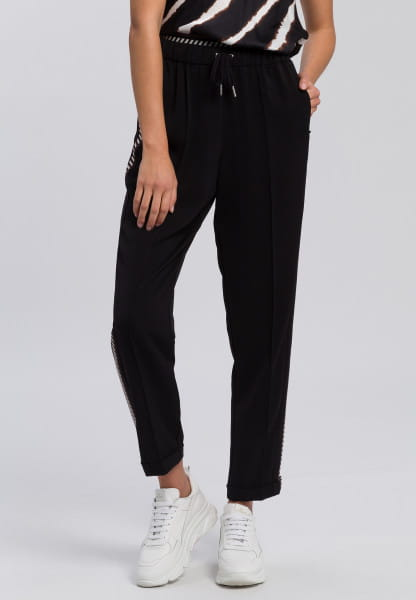 Jogging pants made from crease-resistant material with contrasting stripes