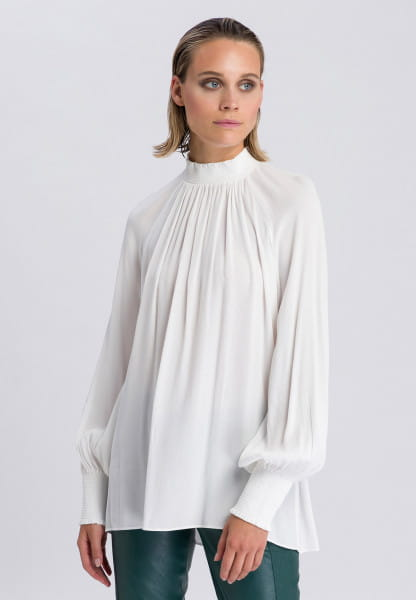 Slip-on blouse with smoked style details