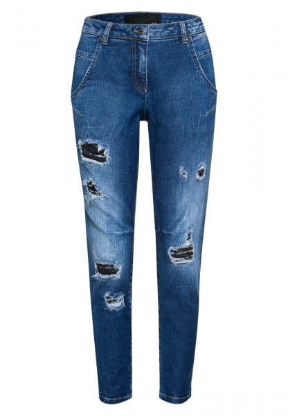 Stretch jeans with striking distressed elements