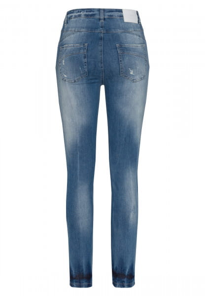 Skinny jeans in blue denim with destroyed effects