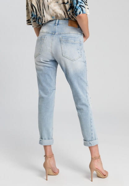 Destroyed jeans made from recycled denim