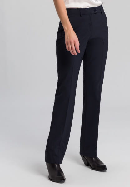Trousers with pleats