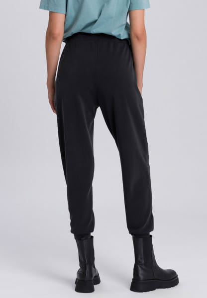 Sweatpants with glossy print at the leg end